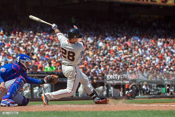 San Francisco Giants catcher Buster Posey at bat and in the release following the trajectory of the ball during the game between the San Francisco...