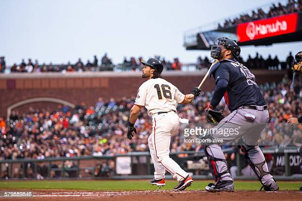 San Francisco Giants center fielder Angel Pagan at bat and following the trajectory of the ball with Atlanta Braves catcher AJ Pierzynski watching...