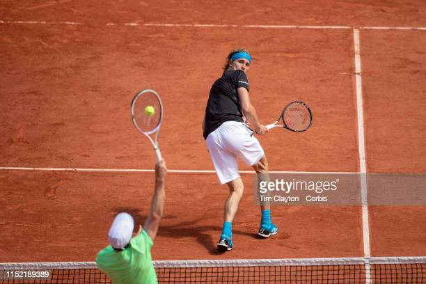May 28 Alexander Zverev of Germany takes evasive action as John Millman of Australia smashes the ball at the net on Court PhilippeChatrier in the...