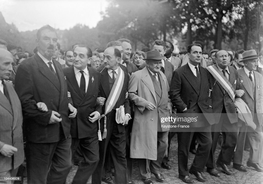 bewteen Place de la Nation and Place de la Republique in Paris, Pierre MENDES FRANCE (the second at left), then delegate of Eure, Edouard DALADIER (at the centre, wearing a hat), behind who stands Charles HERNU (wearing a tie) and Roland DUMAS (whose face is hidden) , and at the right side of DALADIER, Francois MITTERRAND, all of them leading a 'republican defense' demonstration against the return of DE GAULLE at power after the government became vacant after the insurrection of the 'pied-noirs' in Algeria, on the 13th of May 1958. MENDES FRANCE, fervent defender of the Republic and of democracy, is opposing...