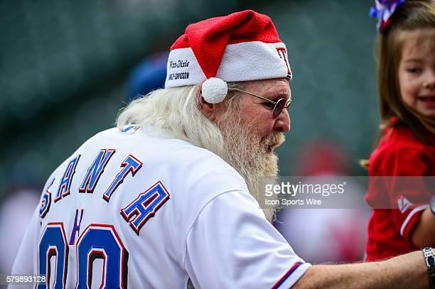 Santa hands out candy canes prior to the Red Sox at Rangers baseball game at Globe Life Park, Arlington, Texas.