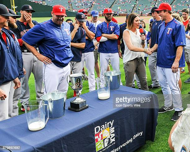 Texas Rangers Pitcher Ross Ohlendorf is congratulated after winning the cow milking contest prior to the Red Sox at Rangers baseball game at Globe...