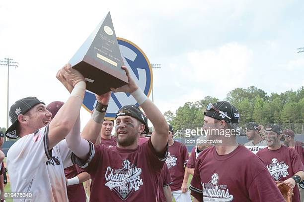 Texas AM players hoist the SEC tournament trophy after winning the Texas AM versus Florida Final Round game of the SEC Baseball Tournament at Hoover...