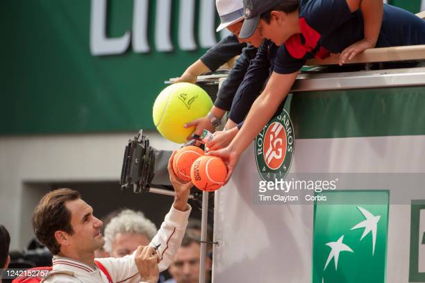 May 29. Roger Federer of Switzerland signs autographs after his victory against Oscar Otte of Germany on Court Philippe-Chatrier in the Men's Singles...