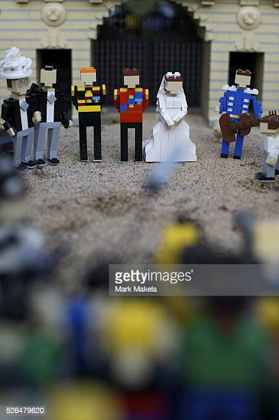 May 3 2011 Windsor England UK Tourists huddle around a miniature display of Buckingham Palace and the royal wedding in LegoLand the day after the...