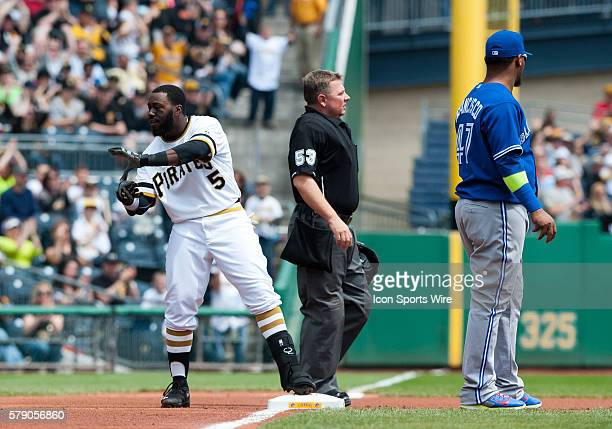 Pittsburgh Pirates third baseman Josh Harrison flashes the Zoltan sign after hitting a triple during the first inning in the game between the Toronto...