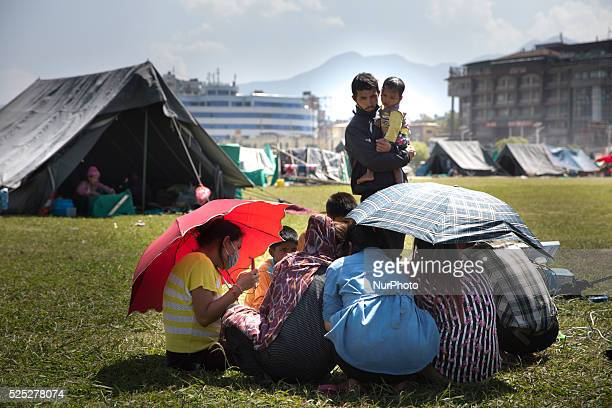 KATHMANDU NEPAL May 3 2015People living in a camp in the center of Kathmandu charge mobile phones using a solar panel following the April 25...
