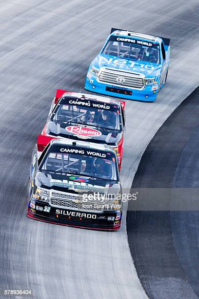 Ben Rhodes driver of the Alpha Energy Solutions Chevy truck leads Ron Hornaday Jr driver of the Rheem Chevy truck and German Quiroga driver of the...