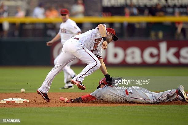 May 30, 2014; Cincinnati Reds center fielder Billy Hamilton reaches second base safely on a steal attempt after a throw gets away from Arizona...