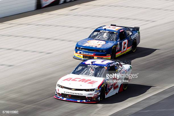 Brian Scott NASCAR XFINITY Series driver of the ACME/Kraft Singles Chevrolet and Carl Long in the Braille Battery/Grafoid Dodge during the Buckle Up...