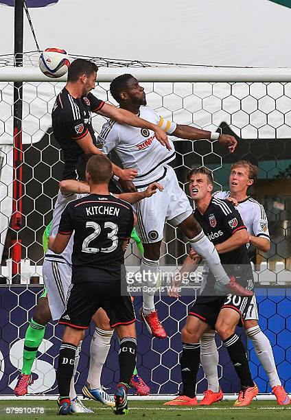 United defender Steve Birnbaum battles for a header with Philadelphia Union midfielder Maurice Edu during a MLS soccer match at RFK Stadium, in...