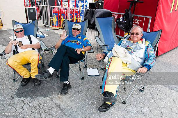 Members of the Sunoco crew seek shelter for the sun under a canopy during Saturday's 2nd practice session for the FedEx 400 Benefiting Autism Speaks...