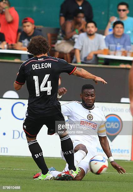 Philadelphia Union midfielder Maurice Edu slide tackles D.C. United midfielder Nick DeLeon during a MLS soccer match at RFK Stadium, in Washington...
