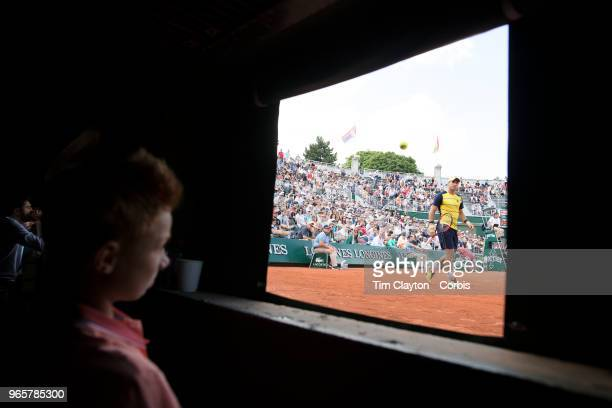 May 30 French Open Tennis Tournament Day Four A ball boy watches from the pit area on Court One as Dusan Lajovic of Serbia plays against Alexander...