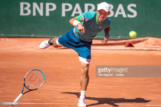 May 30. Kei Nishikori of Japan loses the grip of his tennis racquet while serving against Alessandro Giannessi of Italy, Nishikori managed to...