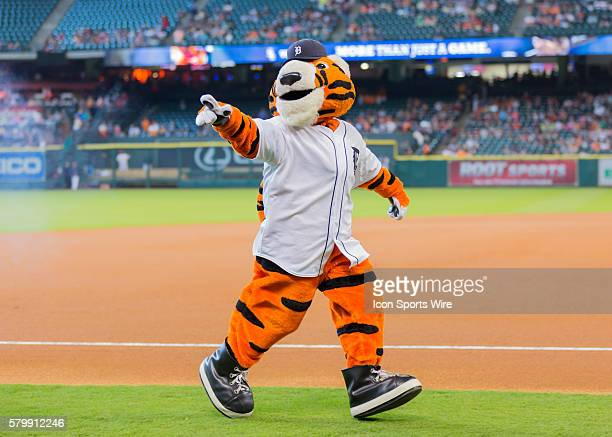 Detroit Tiger mascot Paws celebrates Houston Astros mascot Orbit's 50th birthday during the MLB game between the Chicago White Sox and the Houston...
