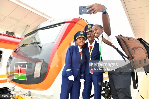 MOMBASA May 31 2017 A Kenyan journalist poses for selfies with female train driver Concilia and Alice during the launching day of the MombasaNairobi...