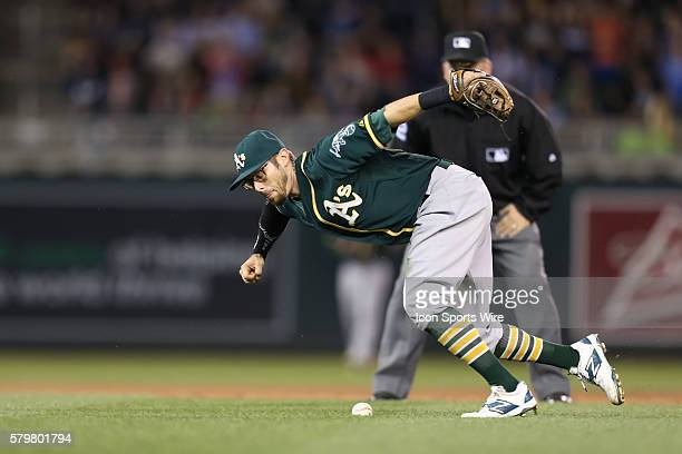 May 4 2015 Oakland Athletics infielder Eric Sogard can't find the handle on a ground ball at the Minnesota Twins vs Oakland Athletics at Target Field...