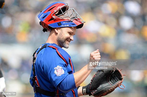 Chicago Cubs Catcher David Ross [3068] cheers as he looks back at the dugout during the Pittsburgh Pirates 62 loss against the Chicago Cubs at PNC...
