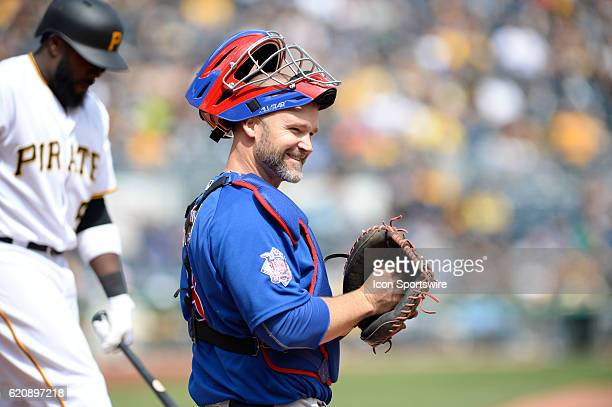Chicago Cubs catcher David Ross [3068] smiles back to his dugout during the Pittsburgh Pirates 6-2 loss against the Chicago Cubs at PNC Park in...