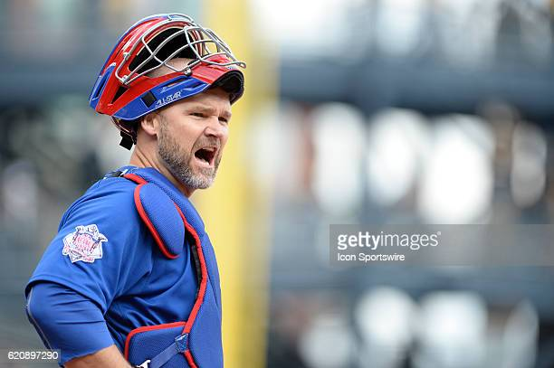 Chicago Cubs catcher David Ross [3068] yells back to his dugout during the Pittsburgh Pirates game versus the Chicago Cubs at PNC Park in Pittsburgh,...