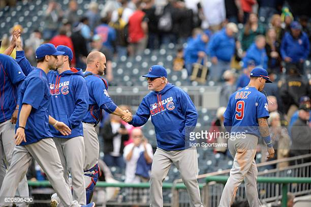 Chicago Cubs Manager Joe Maddon congratulates Chicago Cubs Catcher David Ross [3068] after their 6-2 win against the Pittsburgh Pirates at PNC Park...