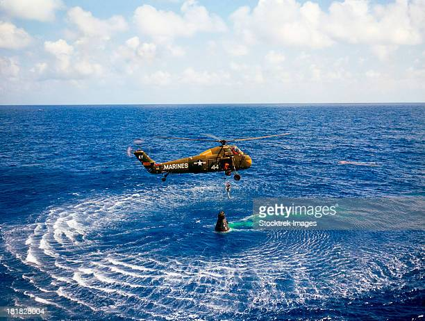 may 5, 1961 - an astronaut is rescued by a u.s. marine helicopter at the termination of his suborbital flight down range from the florida eastern coast.  - landing touching down stock pictures, royalty-free photos & images