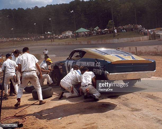 David Pearson pits his HolmanMoody Ford Torino during the Fireball 300 NASCAR Cup race at AshevilleWeaverville Speedway Pearson went on to capture...