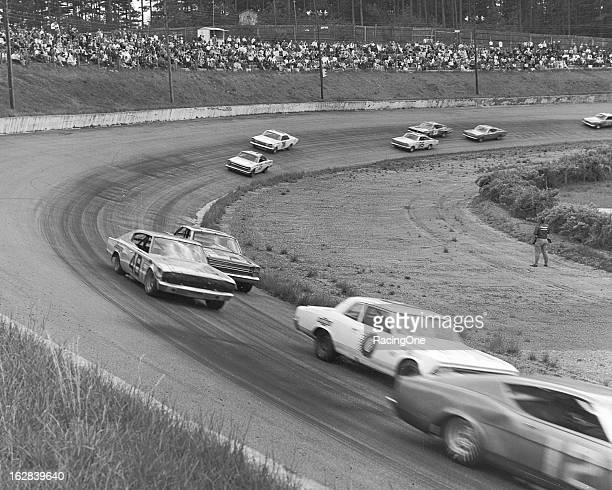 Tom Pistone leads Dr Don Tarr James Hylton and others during the Fireball 300 NASCAR Cup race at AshvilleWeaverville Speedway