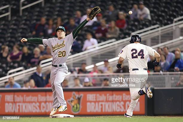 May 6 2015 Oakland Athletics infielder Mark Canha can't reach the overthrow and infielder Trevor Plouffe is safe at first at the Minnesota Twins vs...