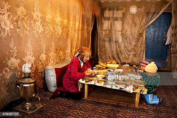 May 7 Khinalig Village Guba district Azerbaijan A woman shares a meal with a child in her house in Khinalig The northern village is referred to as an...