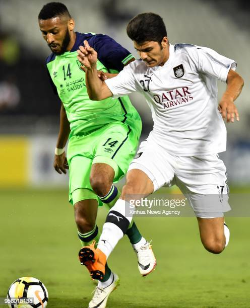 DOHA May 8 2018 Ahmed Suhail of Al Sadd SC vies with Mohannad Aseri of Al Ahli Saudi during the round of 16 in the AFC Asian Champions League...