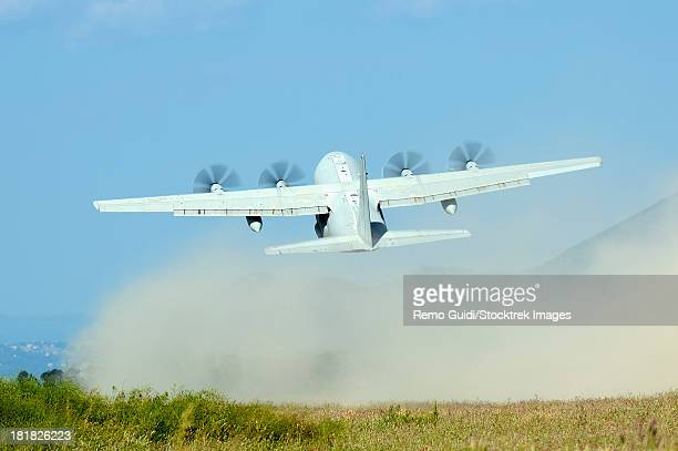 May 9, 2013 - A C-130 Hercules of the Italian Air Force taking off from an unpaved landing strip, Grazzanise, Italy.
