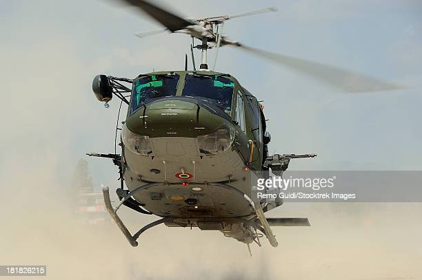 May 9, 2013 - An Agusta Bell AB 212 of the Italian Air Force landing for personnel recovery, Grazzanise, Italy.