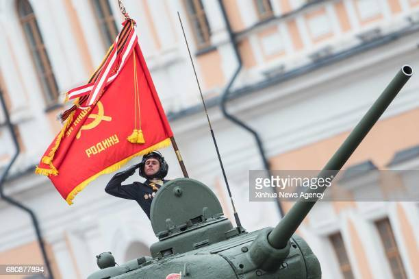 MOSCOW May 9 2017 A soldier salutes on a tank during the Victory Day parade in Moscow Russia May 9 2017 Russia marks on Tuesday the 72nd anniversary...