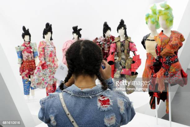 NEW YORK May 9 2017 A visitor takes photos of the works designed by Rei Kawakubo at Costume Institute's spring 2017 exhibition in Metropolitan Museum...