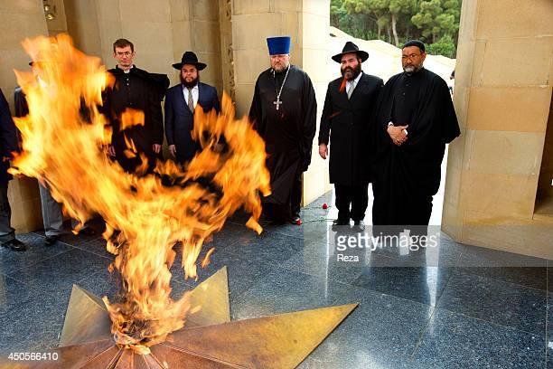 May 9 Martyrs Lane Baku Azerbaijan Christian Jewish and Muslim representatives stand around the Eternal Flame memorial at Martyrs Lane Many...