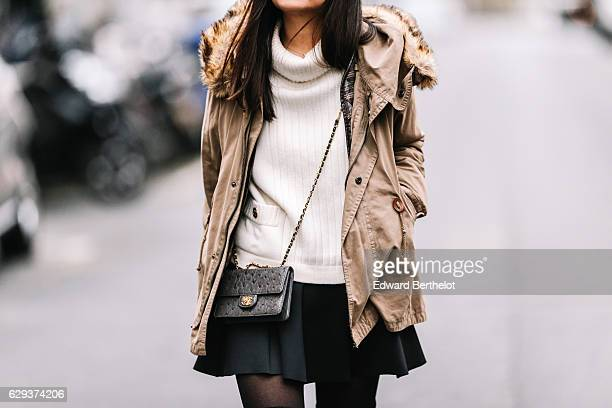 May Berthelot fashion and life style blogger is wearing a Chanel white turtleneck sweater a Topshop black skater skirt Zara black thigh high boots a...