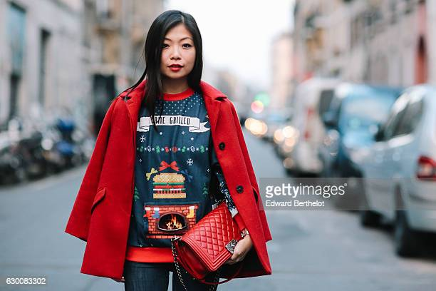 May Berthelot fashion and life style blogger is wearing a Rad x Burger King Christmas sweater featuring an animated grill fire on the front with the...