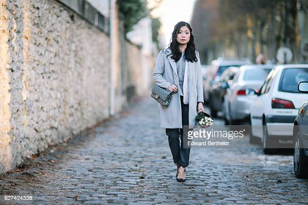 May Berthelot fashion and life style blogger is wearing a wedding themed outfit consisting of a New Look gray long coat a Sandro jacket a Christian...