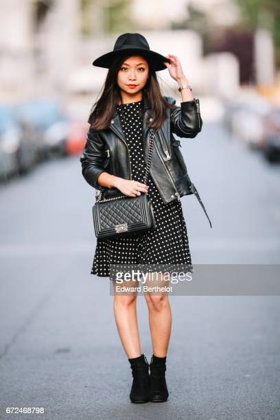 May Berthelot fashion blogger and Head of Legal at Videdressingcom wears a Newlook black dress with white prints a Newlook black hat Zara boots a The...