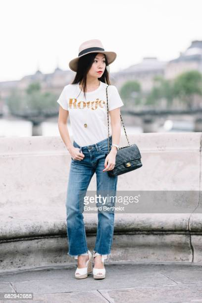 May Berthelot fashion blogger and Head of Legal at Videdressingcom wears a The Kooples hat Maje jeans a Rouje by Jeanne Damas tshirt a Delphine...