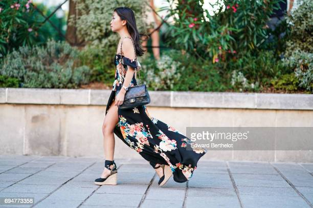 May Berthelot fashion blogger and Head of Legal at Videdressingcom wears a New Look offshoulder long floral print black dress a Chanel bag and HM...