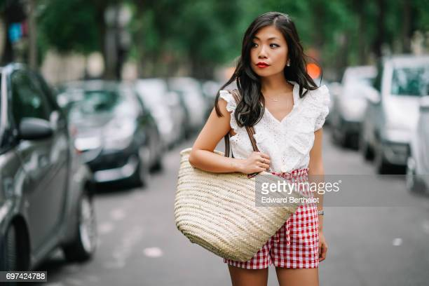 May Berthelot fashion blogger and Head of Legal at Videdressingcom wears a New Look red gingham short a Mode in Elo white sleeveless ruffled lace top...