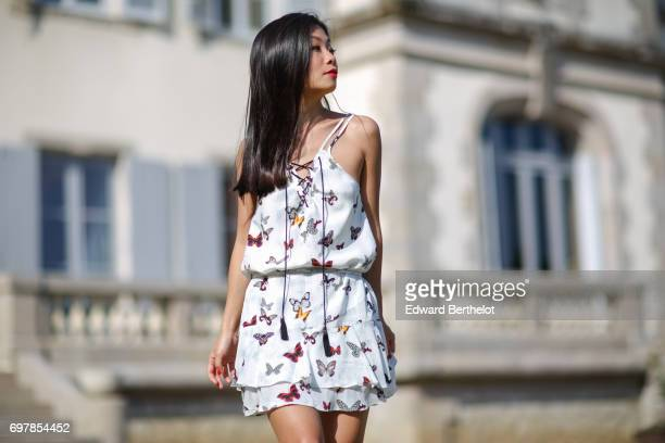 May Berthelot fashion blogger and Head of Legal at Videdressingcom wears a The Kooples white lace flower print dress and Zara shoes at Chateau de...