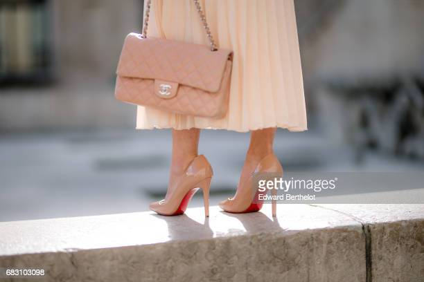 May Berthelot fashion blogger and Head of Legal at Videdressingcom wears an Asos white ruffled top an Asos pleated pink skirt Louboutin Pigalle 100...