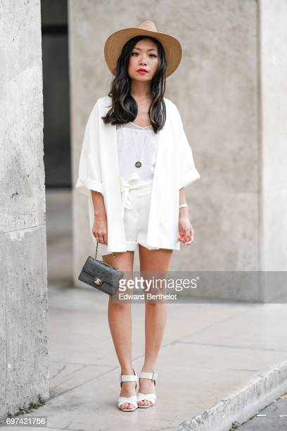 May Berthelot fashion blogger wears a New Look white kimono a New Look white short a Sandro white lace top a hat a Chanel bag and Zara sandals shoes...