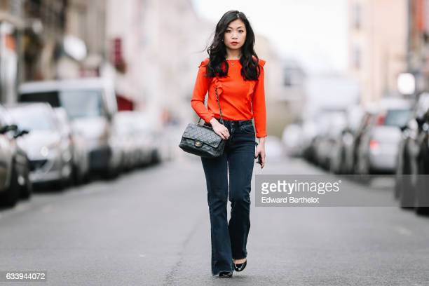 May Berthelot Head of Legal at Videdressingcom and fashion blogger wears a Newkook red ruffle top Newlook denim flare jeans pants Valentino Tango...