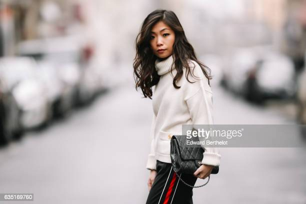 May Berthelot Head of Legal at Videdressingcom and fashion blogger wears a Chanel white turtleneck pull over a Chanel bag Zara sportswear pants with...