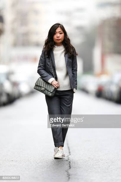 May Berthelot Head of Legal at Videdressingcom and fashion blogger wears a Zara gray suit an Acne Studios white pull over Converse white shoes a...